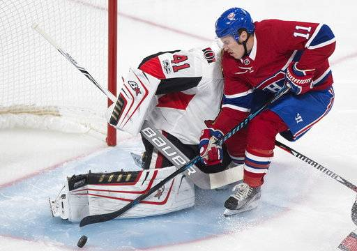 Montreal Canadiens' Brendan Gallagher slides in on Ottawa Senators goaltender Craig Anderson during first period of an NHL preseason hockey game in Montreal, Saturday, Sept. 30, 2017. (Graham Hughes/The Canadian Press via AP)