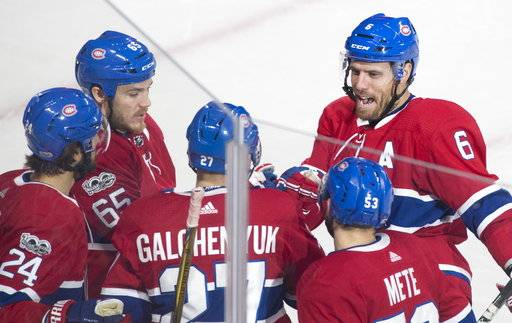 Montreal Canadiens' Alex Galchenyuk (27) celebrates with teammates Phillip Danault (24), Andrew Shaw (65), Shea Weber (6) and Victor Mete (53) after scoring against the Ottawa Senators during the first period of an NHL preseason hockey game in Montreal, Saturday, Sept. 30, 2017. (Graham Hughes/The Canadian Press via AP)