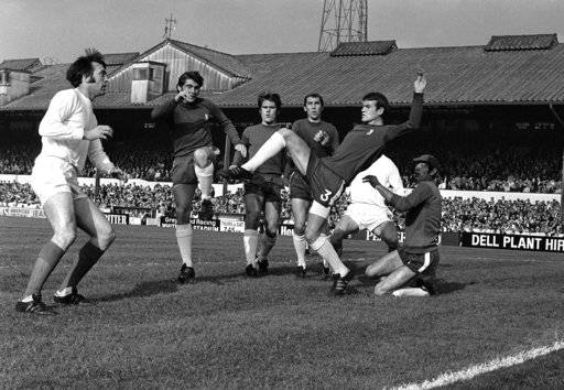 FILE - In this Oct. 18, 1969 file photo, Chelsea's Eddie McCreadie, second right, kicks clear from scrimmage in front West Bromwich's Jeff Astle, left, during the English League Division one soccer match between Chelsea and West Bromwich Albion at Stamford Bridge Stadium in London. The family of former England striker Jeff Astle, whose death at age 59 in 2002 was attributed to repeatedly heading heavy, leather balls, has been pushing for better protection for modern players.