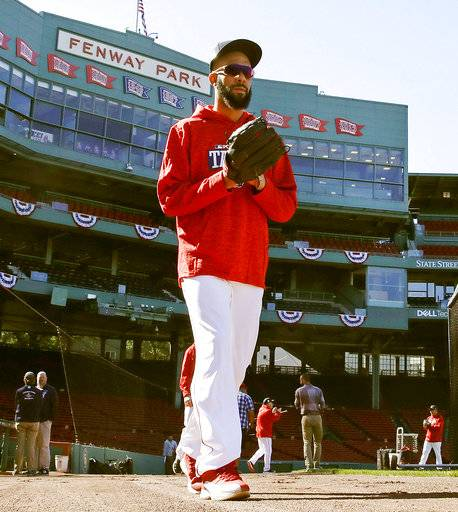 Boston Red Sox relief pitcher David Price walks to the outfield to work out during baseball practice at Fenway Park in Boston, Tuesday, Oct. 3, 2017. The Red Sox face the Houston Astros in the American League Division playoff series.