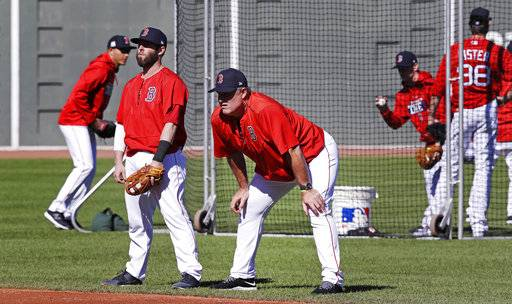 Boston Red Sox second baseman Dustin Pedroia, left, talks with manager John Farrell during baseball practice at Fenway Park in Boston, Tuesday, Oct. 3, 2017. The Red Sox face the Houston Astros in the American League Division playoff series.