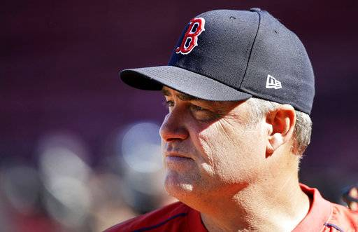 Boston Red Sox manager John Farrell watches players during a workout at Fenway Park in Boston, Tuesday, Oct. 3, 2017. The Red Sox face the Houston Astros in the American League Division playoff series.