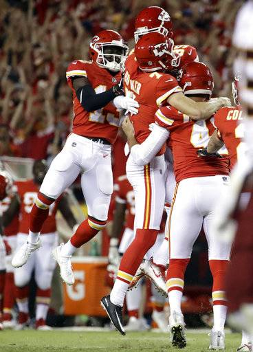 Kansas City Chiefs players celebrate with kicker Harrison Butker (7) after he kicked the go-ahead field goal late in the fourth quarter of an NFL football game against the Washington Redskins in Kansas City, Mo., Monday, Oct. 2, 2017. The Chiefs won 29-20.