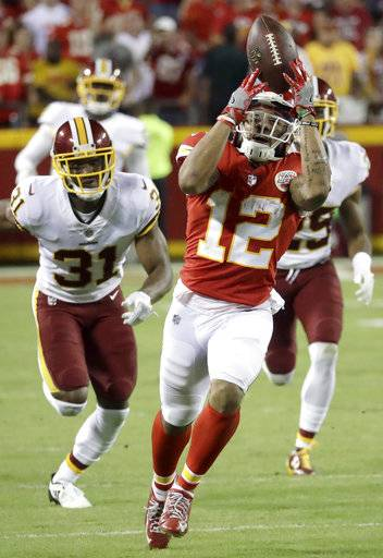 Kansas City Chiefs wide receiver Albert Wilson (12) makes a catch as Washington Redskins cornerback Fabian Moreau (31) pursues during the second half of an NFL football game in Kansas City, Mo., Monday, Oct. 2, 2017. The Chiefs won 29-20.