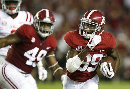 FILE - In this Saturday, Sept. 30, 2017, file photo, Alabama defensive back Levi Wallace runs the ball after an interception against Mississippi quarterback Shea Patterson during the first half of an NCAA college football game in Tuscaloosa, Ala. Wallace, from Tucson, Ariz., walked on at Alabama in 2014 and did not play at all until last season, when he earned a scholarship and mostly contributed on special teams. Now he is starting on a team full of blue-chip recruits.