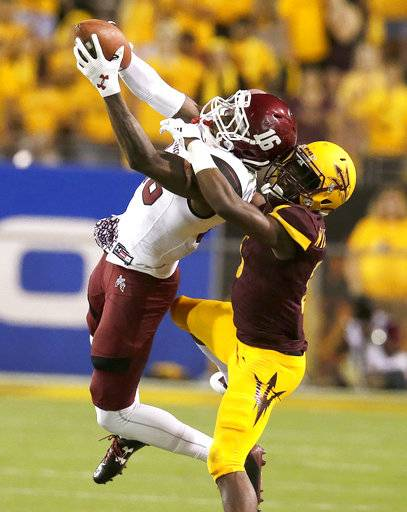 FILE - In this Aug. 31, 2017, file photo, New Mexico State wide receiver Jaleel Scott (16) makes a catch in front of Arizona State defensive back Kobe Williams during the second half of an NCAA college football game in Tempe, Ariz. Scott ranks 13th in the nation in yards receiving per game at 108.6 and has scored five touchdowns. Last week against Arkansas, he had his best game of the season with nine catches for 174 yards and a touchdown.