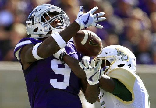 FILE - In this Saturday, Sept. 30, 2017, file photo, Baylor cornerback Jameson Houston, right, breaks up a pass intended for Kansas State wide receiver Byron Pringle (9) during the first half of an NCAA college football game in Manhattan, Kan. Five times. That's how many times Kansas State threw the ball in the second half against Baylor. Part of it was due to the score, but part of it was also due to ongoing trouble in the Wildcats passing game