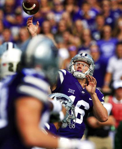 FILE - In this Saturday, Sept. 30, 2017, file photo, Kansas State quarterback Jesse Ertz passes down field during the first half of an NCAA college football game against Baylor in Manhattan, Kan. Five times. That's how many times Kansas State threw the ball in the second half against Baylor. Part of it was due to the score, but part of it was also due to ongoing trouble in the Wildcats passing game.