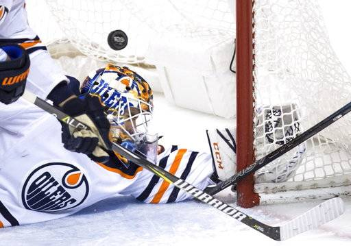 Edmonton Oilers' goalie Cam Talbot allows a goal to Vancouver Canucks' Loui Eriksson, of Sweden, during the second period of a preseason NHL hockey game in Vancouver, British Columbia, Saturday, Sept. 30, 2017. (Darryl Dyck/The Canadian Press via AP)