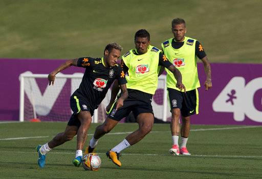 Brazil's Neymar, from left, Paulinho, and Dani Alves, train in preparation for an upcoming World Cup qualifying match, in Teresopolis, Brazil, Monday, Oct. 2, 2017.