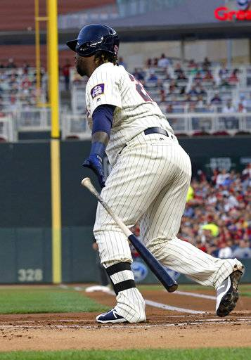 Minnesota Twins' Miguel Sano hits a single to load the bases off Detroit Tigers pitcher Buck Farmer during the first inning of a baseball game Saturday, Sept. 30, 2017, in Minneapolis.