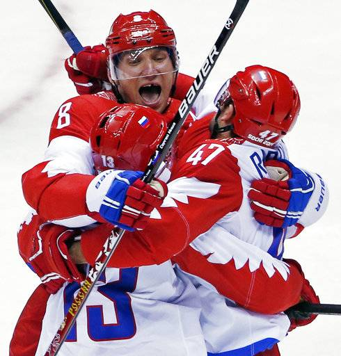 "FILE - In this Feb. 15, 2014, file photo, Russia forward Alexander Ovechkin, top, reacts with forward Pavel Datsyuk after Datsyuk scored a third period goal against the USA during a men's ice hockey game at the 2014 Winter Olympics, in Sochi, Russia. Instead of going to South Korea this winter to play for their countries, NHL players must reckon with an 82-game season that rolls on without the Olympics while counterparts in the minors, college and Europe take their places. Ovechkin, who was vocal about saying he'd go no matter what, said last month that he and other players have never had to choose between their NHL teams and the Olympics and ""should not have to be in position to make this choice.�"