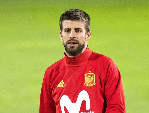 FILE  - In this Monday, Sept 4, 2017 file photo, Spain's Gerard Pique takes part in a training session a day prior to the World Cup Group G qualifying soccer match between Liechtenstein and Spain at the Rheinpark stadium in Vaduz, Liechtenstein. Spain coach Julen Lopetegui has defended Gerard Pique from critics who question his loyalty to the national team because of his support for a disputed referendum on Catalan independence. (Gian Ehrenzeller/Keystone via AP, FIle)