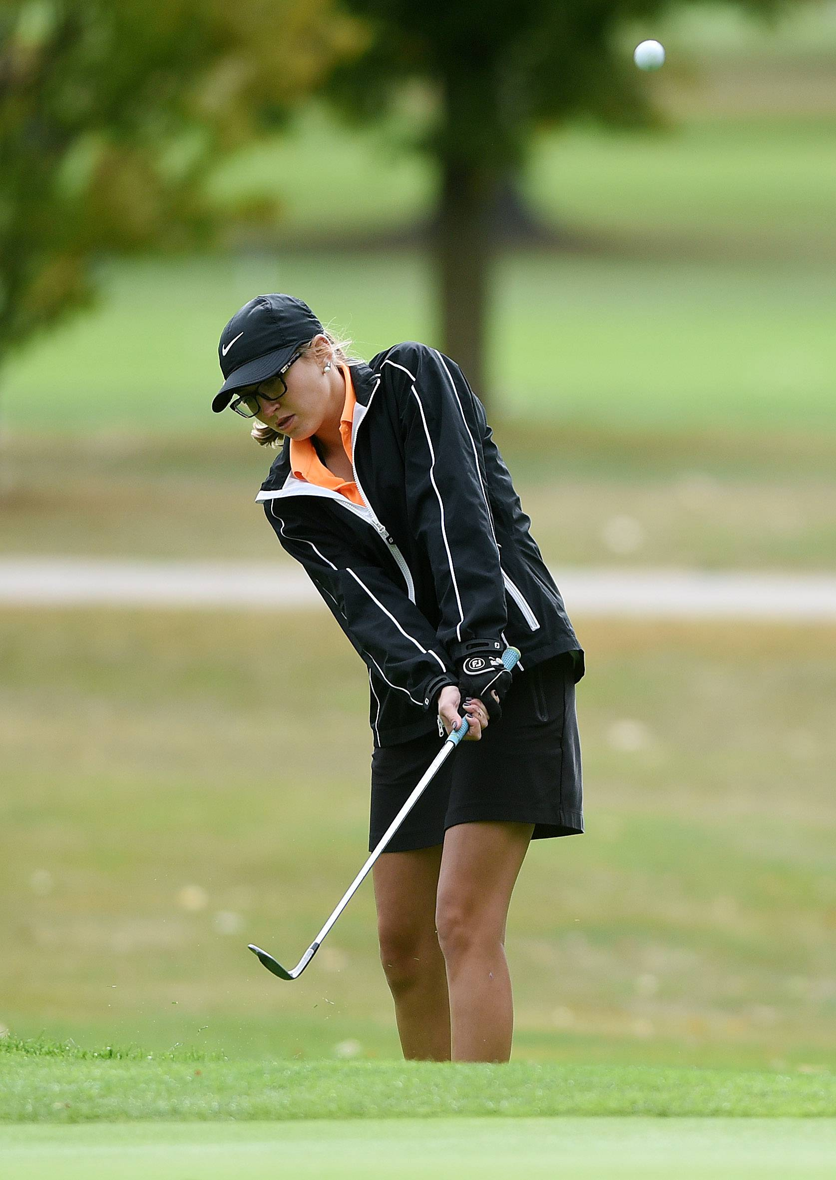 St. Charles East's Nicole Jordan chips on to the green during the Burlington Central girls golf regional at Sycamore Golf Club Wednesday.