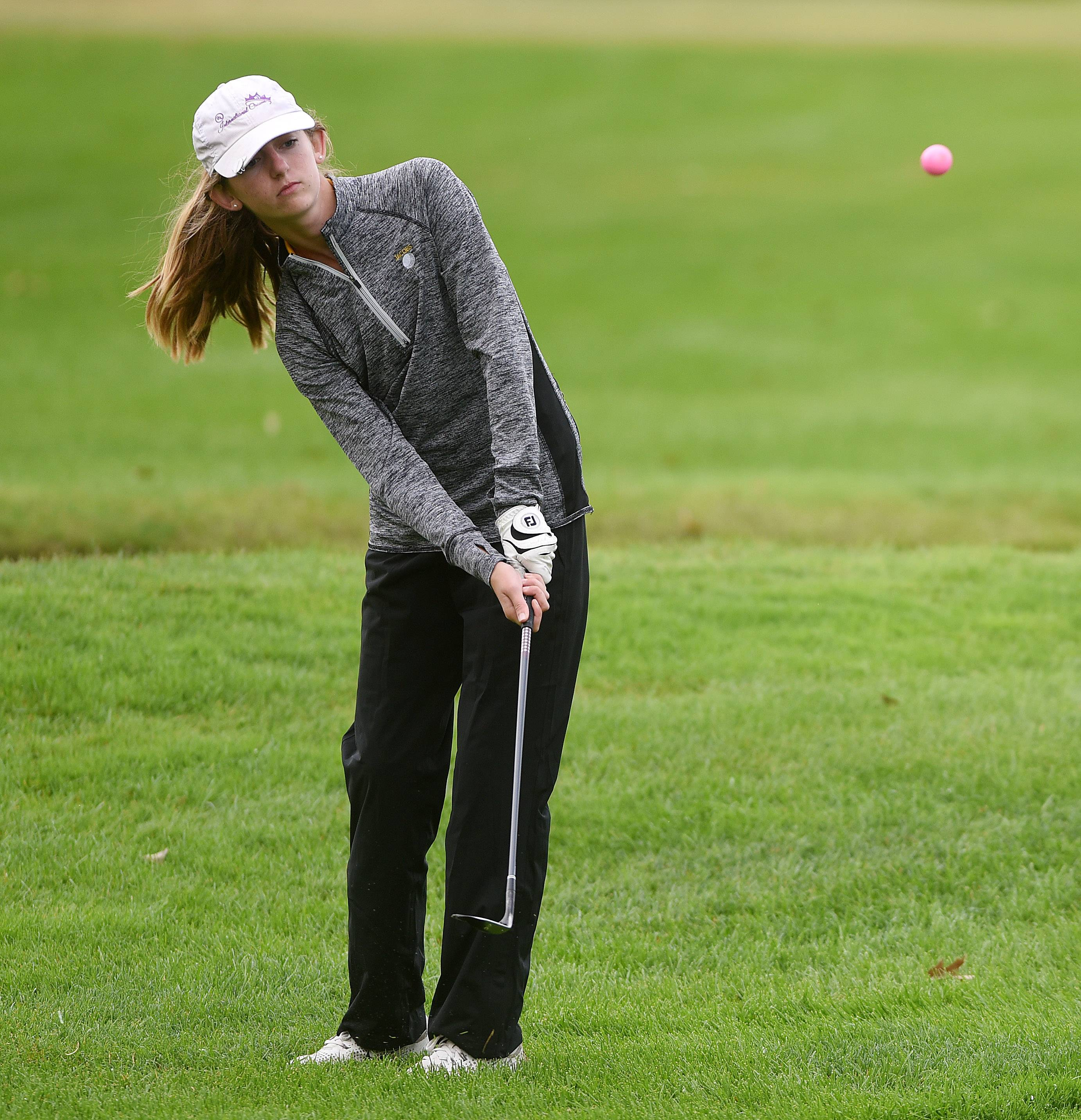 Lauren Kempf of Jacobs chips on to the green during the Burlington Central girls golf regional at Sycamore Golf Club Wednesday.