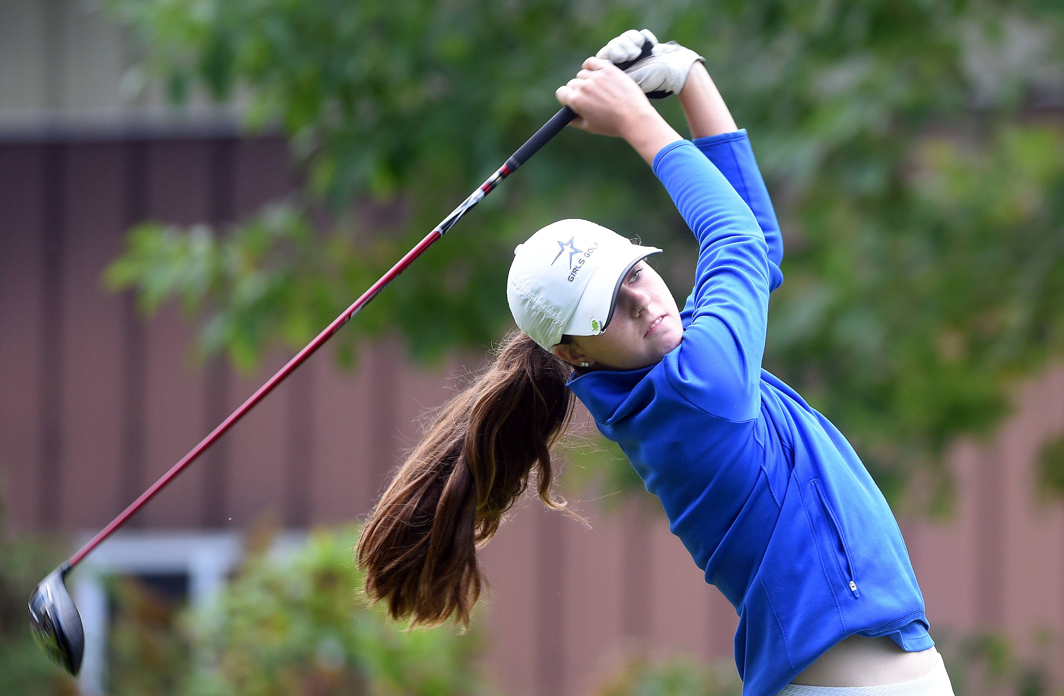 St. Charles North's Sarah Arnold tees off on the 3rd hole during the Burlington Central girls golf regional at Sycamore Golf Club Wednesday.