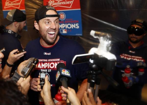 Chicago Cubs starting pitcher John Lackey celebrates after defeating the  St. Louis Cardinals in a 75f7f3035d3
