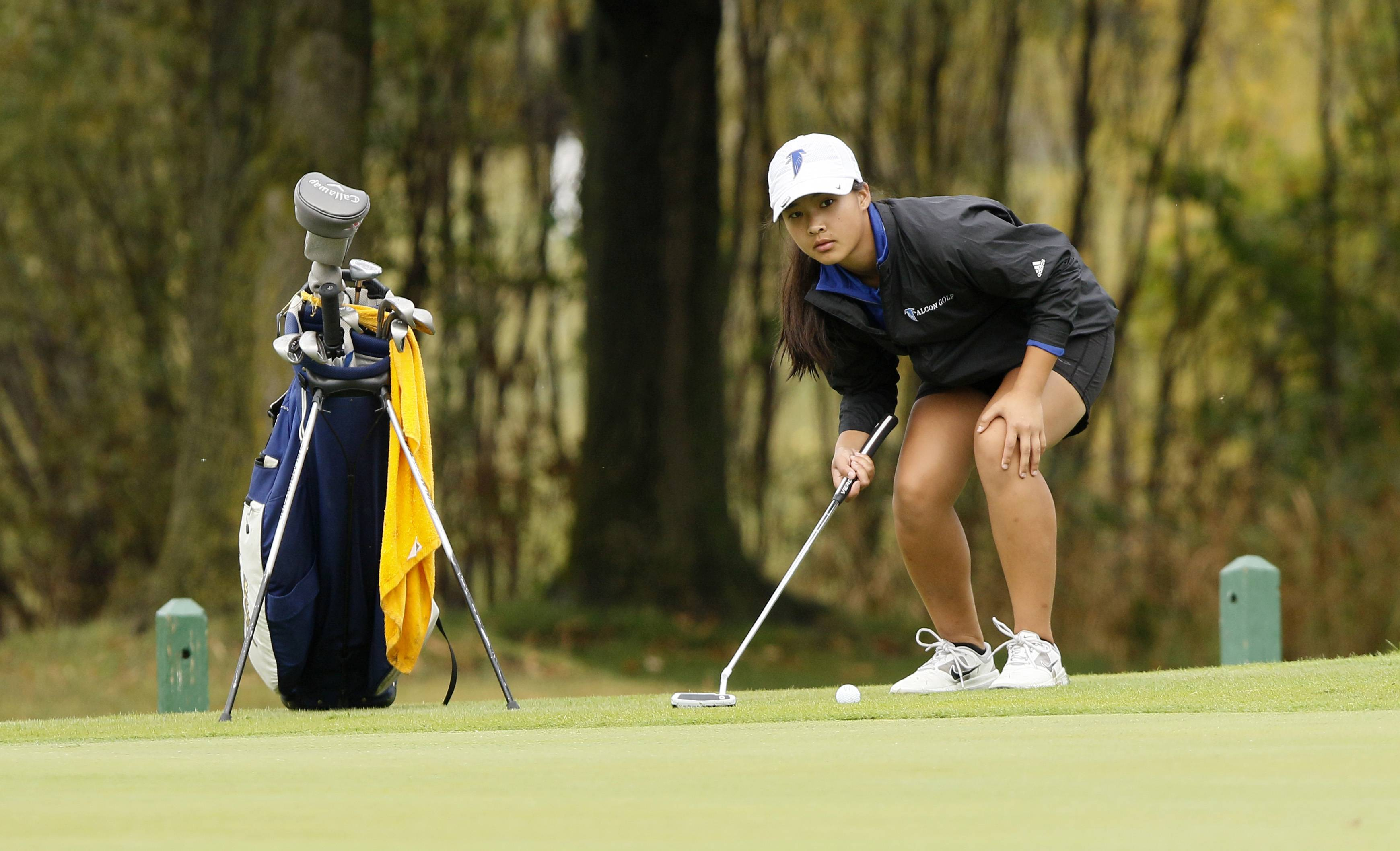 Wheaton North's Maddie Stevens eyes her putt on the 9th green during the Class 2A Nazareth girls golf regional at Links of the Carillon golf course in Plainfield.