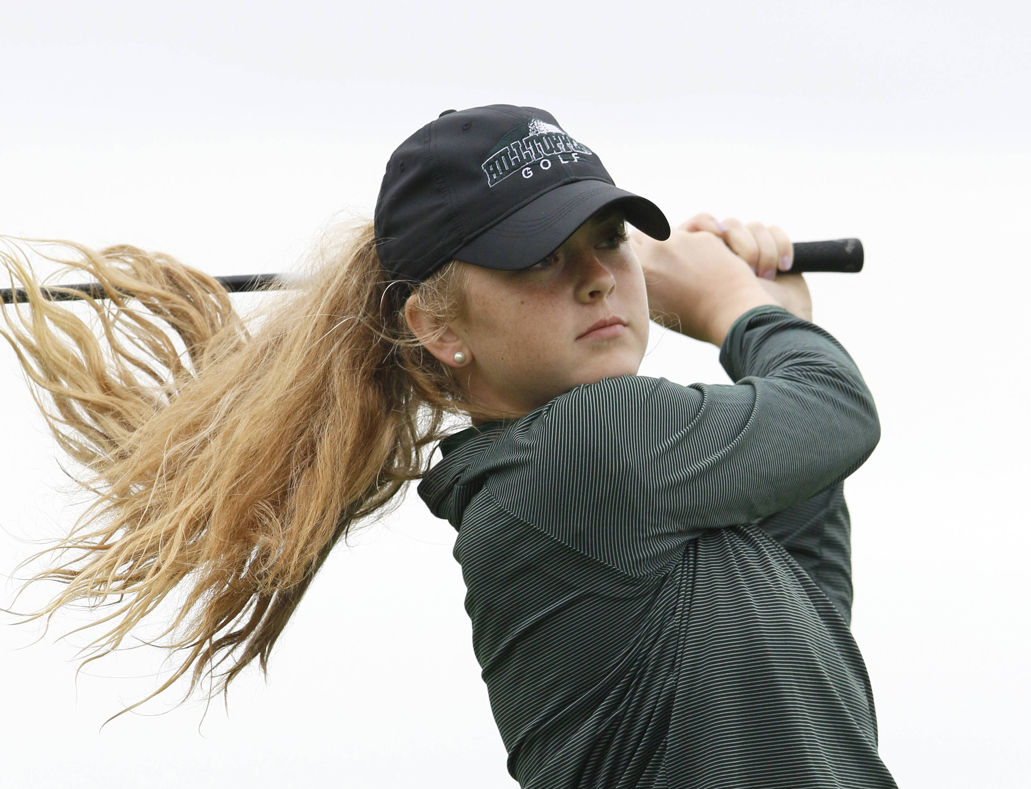 Glenbard West's Ann Bertane tees off at the 9th hole during the Class 2A Nazareth girls golf regional at Links of the Carillon golf course in Plainfield.