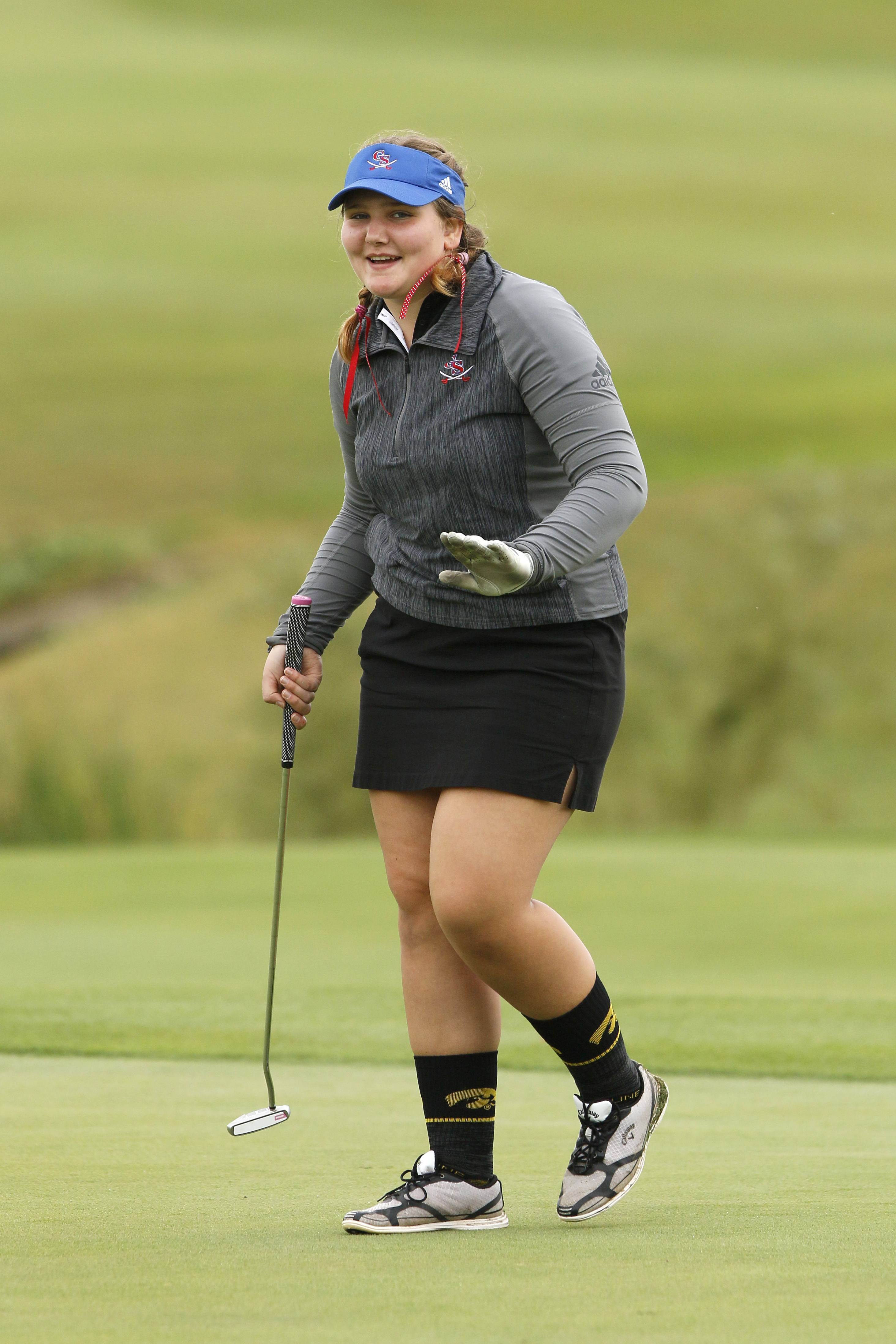 Glenbard South's Stephanie Price reacts to her putt during the Class 2A Nazareth girls golf regional at Links of the Carillon golf course in Plainfield.