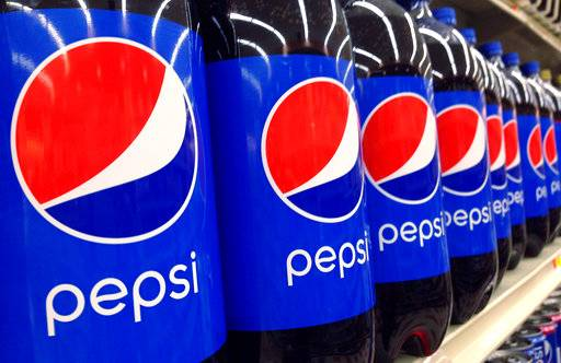 FILE - In this July 9, 2015, file photo, Pepsi bottles are on display for sale at a supermarket in Haverhill, Mass. PepsiCo Inc. reports earnings, Wednesday, Oct. 4, 2017.