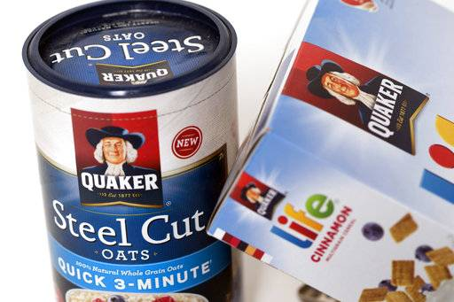 FILE - In this Friday, April 21, 2017, file photo, Quaker Oats Company products are arranged for a photo in Surfside, Fla. PepsiCo Inc., the parent company of the Quaker Oats brand, reports earnings, Wednesday, Oct. 4, 2017.