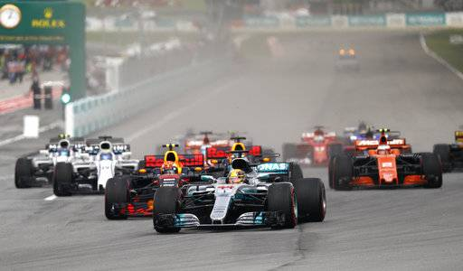 Mercedes driver Lewis Hamilton of Britain leads the field into turn one at the start of the Malaysian Formula One Grand Prix in Sepang, Malaysia, Sunday, Oct. 1, 2017.
