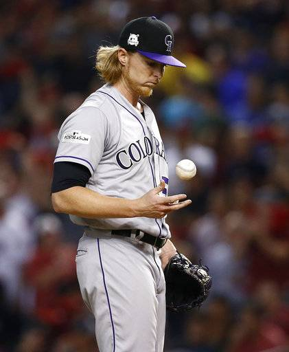Colorado Rockies starting pitcher Jon Gray flips the ball after giving up a base hit during the second inning of the National League wild-card playoff baseball game against the Arizona Diamondbacks, Wednesday, Oct. 4, 2017, in Phoenix.