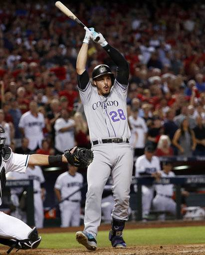 Colorado Rockies' Nolan Arenado (28) avoids an inside pitch from the Arizona Diamondbacks during the fifth inning of the National League wild-card playoff baseball game, Wednesday, Oct. 4, 2017, in Phoenix.