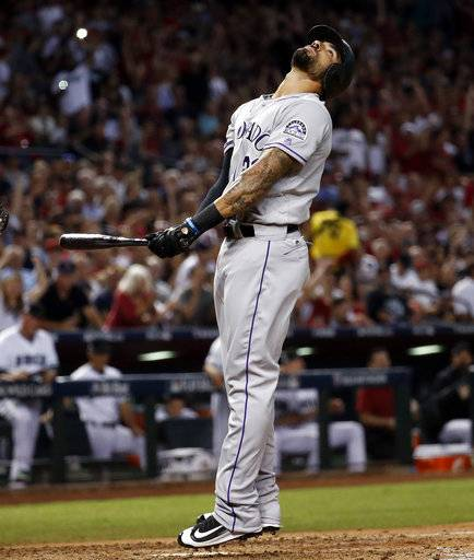 Colorado Rockies' Ian Desmond reacts to striking out against the Arizona Diamondbacks during the seventh inning of the National League wild-card playoff baseball game, Wednesday, Oct. 4, 2017, in Phoenix.