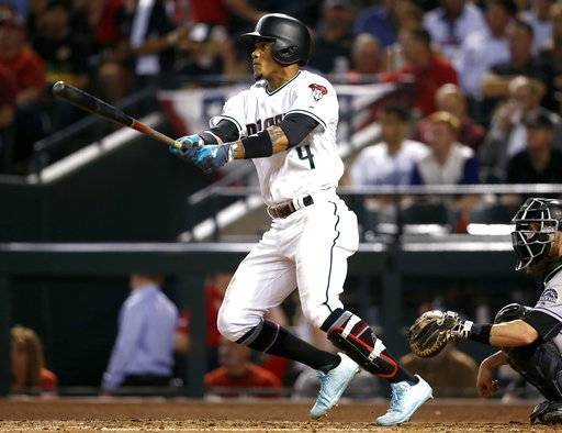 Arizona Diamondbacks' Ketel Marte follows through on a triple against the Colorado Rockies during the fourth inning of the National League wild-card playoff baseball game, Wednesday, Oct. 4, 2017, in Phoenix.