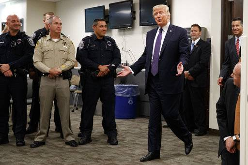 President Donald Trump arrives to meet with first responders at the Las Vegas Metropolitan Police Department, Wednesday, Oct. 4, 2017, in Las Vegas.