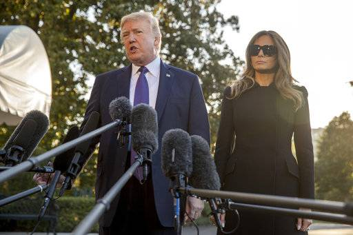 President Donald Trump, accompanied by first lady Melania Trump, speaks to reporters before boarding Marine One on the South Lawn of the White House in Washington, Wednesday, Oct. 4, 2017, for a short trip to Andrews Air Force Base, Md., and then on to Las Vegas to visit with victims and first responders affected by the worst mass shooting in American history.