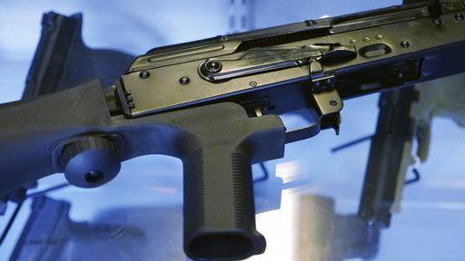 "A little-known device called a ""bump stock"" is attached to a semi-automatic rifle at the Gun Vault store and shooting range Wednesday, Oct. 4, 2017, in South Jordan, Utah. Las Vegas shooter Stephen Paddock bought 33 guns within the last year, but that didn't raise any red flags. Neither did the mountains of ammunition he was stockpiling, or the bump stocks found in his hotel room that allow semi-automatic rifles to mimic fully automatic weapons."