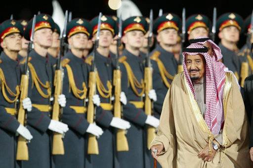Saudi King Salman reviews a honor guards upon arrival in Moscow's Government Vnukovo airport, Russia, Wednesday, Oct. 4, 2017. The King's visit is the first trip to Russia by a sitting Saudi monarch.
