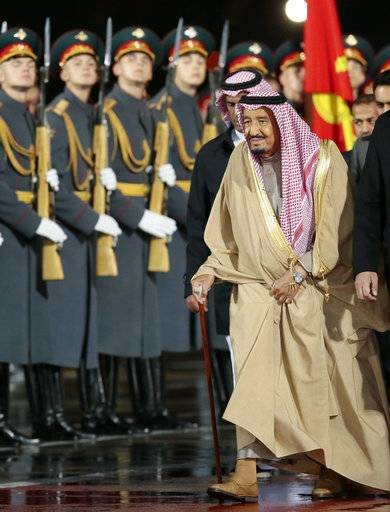Saudi King Salman reviews the honor guards upon his arrival at Moscow's Government Vnukovo airport, Russia, Wednesday, Oct. 4, 2017. The King's visit is the first ever trip to Russia by a sitting Saudi monarch.