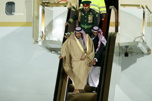 Saudi King Salman steps out of a plane upon arrival in Moscow's Government Vnukovo airport, Russia, Wednesday, Oct. 4, 2017. Salman will meet Russian President Vladimir Putin on Thursday, Oct. 5, 2017.