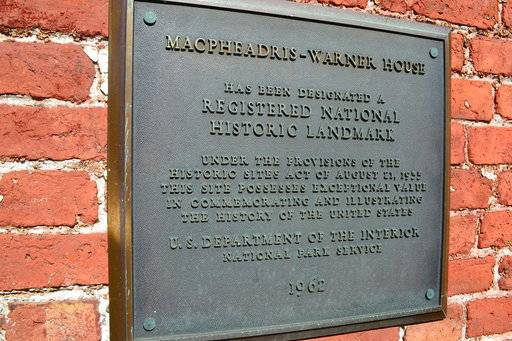 This photo taken Tuesday, Oct. 3, 2017 in Portsmouth, N.H., shows a plaque at the Macphaedris-Warner House which was home to at least eight slaves in the 1700s, including John Jack who would later offer shelter to Ona Judge, a George Washington family slave who escaped to New Hampshire.