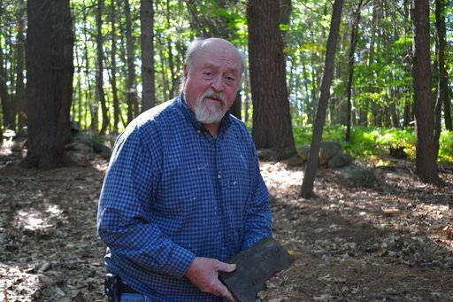 In this photo taken Friday, Sept. 29, 2017 in Greenland, N.H., John Brackett visits a burial site linked to a black family who offered shelter to Ona Judge, a slave who was owned by George Washington's family and escaped to New Hampshire in 1796. The burial site is hidden in the woods on property owned by Brackett.