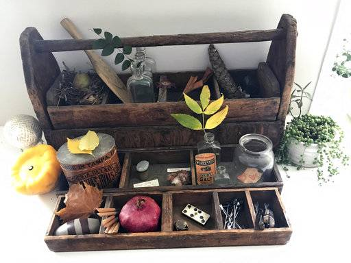 "This Sept. 21, 2017 photo provided by Katie Workman shows a ""cabinet of curiosities,"" with touches of Autumn, inside a home in New York. Fall is a great time to create a ""cabinet of curiosities,"" an idea that goes back centuries. You collect and display knickknacks and oddities, often but not exclusively from nature, for study, inspiration, contemplation or conversation. (Katie Workman via AP)"