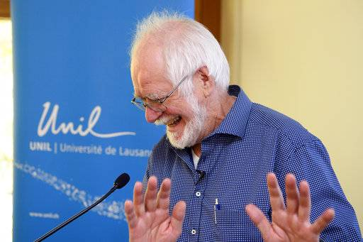 Jacques Dubochet, University of Lausanne, one of the 2017 Nobel Prize winners in Chemistry jokes prior to  a press conference at the University of Lausanne, Unil,  in Lausanne, Switzerland, Wednesday, Oct. 4, 2017. Three researchers based in the U.S., U.K. and Switzerland won the Nobel Prize in Chemistry on Wednesday for developments in electron microscopy. The 9-million-kronor ($1.1 million) prize is shared by Jacques Dubochet of the University of Lausanne, Joachim Frank at New York's Columbia University and Richard Henderson of MRC Laboratory of Molecular Biology in Cambridge, Britain. (Jean-Christophe Bott/Keystone via AP)