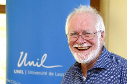 Jacques Dubochet, University of Lausanne, one of the 2017 Nobel Prize winners in Chemistry smiles before a press conference at the University of Lausanne, Unil, in Lausanne Switzerland, Wednesday, Oct. 4, 2017. Three researchers based in the U.S., U.K. and Switzerland won the Nobel Prize in Chemistry on Wednesday for developments in electron microscopy. The 9-million-kronor ($1.1 million) prize is shared by Jacques Dubochet of the University of Lausanne, Joachim Frank at New York's Columbia University and Richard Henderson of MRC Laboratory of Molecular Biology in Cambridge, Britain. (Jean-Christophe Bott/Keystone via AP)