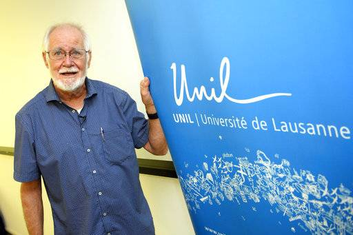 Jacques Dubochet, University of Lausanne, one of the 2017 Nobel Prize winners in Chemistry poses prior to a press conference at the University of Lausanne, Unil, in Lausanne Switzerland, Wednesday, Oct. 4, 2017. Three researchers based in the U.S., U.K. and Switzerland won the Nobel Prize in Chemistry on Wednesday for developments in electron microscopy. The 9-million-kronor ($1.1 million) prize is shared by Jacques Dubochet of the University of Lausanne, Joachim Frank at New York's Columbia University and Richard Henderson of MRC Laboratory of Molecular Biology in Cambridge, Britain. (Jean-Christophe Bott/Keystone via AP)