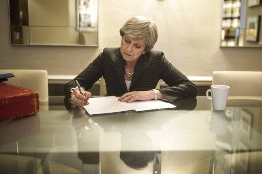 Britain's Prime Minister Theresa May prepares her speech that she will deliver Wednesday at the Conservative party conference, at the Manchester Central Convention Complex in Manchester, England, Tuesday Oct. 3, 2017. (Christopher Furlong/PA via AP)