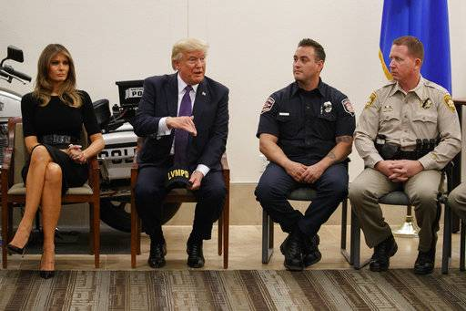 President Donald Trump and first lady Melania Trump meet with first responders and private citizens that helped during the mass shooting, during a event at the Las Vegas Police command center, Wednesday, Oct. 4, 2017, in Las Vegas.