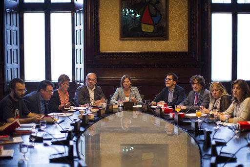 President of the Catalan parliament Carme Forcadell, center, attends a meeting with parliament representatives at the Catalonia Parliament in Barcelona, Spain, Wednesday, Oct. 4, 2017. Catalonia's regional government is mulling when to declare the region's independence from Spain in the wake of a disputed referendum that has triggered Spain's most serious national crisis in decades.
