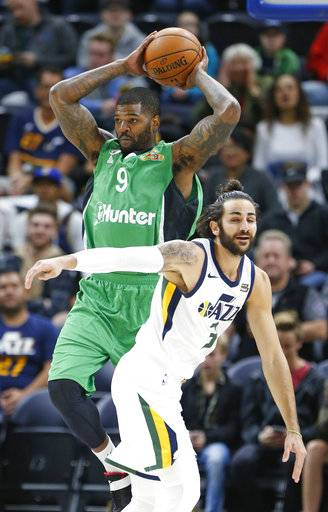 Maccabi Haifa center Josh Smith (9) passes the ball as Utah Jazz guard Ricky Rubio (3) defends during the first half of a preseason NBA basketball game Wednesday, Oct. 4, 2017, in Salt Lake City.