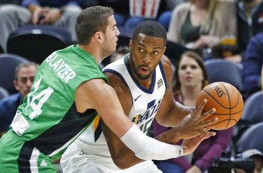 Maccabi Haifa forward Oz Blayzer (14) guards Utah Jazz forward Derrick Favors, right, during the first half of a preseason NBA basketball game Wednesday, Oct. 4, 2017, in Salt Lake City.