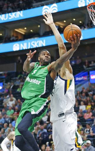 Maccabi Haifa center Josh Smith (9) goes to the basket as Utah Jazz center Rudy Gobert, left, defends during the first half of a preseason NBA basketball game Wednesday, Oct. 4, 2017, in Salt Lake City.