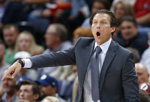 Utah Jazz head coach Quin Snyder shouts to his team during the first half of a preseason NBA basketball game against Maccabi Haifa Wednesday, Oct. 4, 2017, in Salt Lake City.